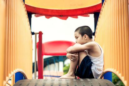 boy sad at playground children mental health issues