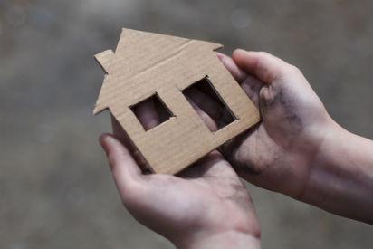 orphan dirty hands cardboard house