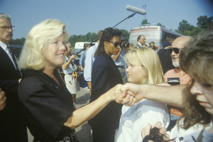 tipper gore shaking hands press