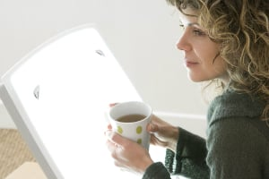 woman coffee light therapy