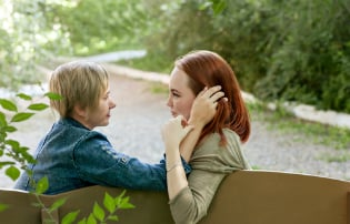 lesbian couple park bench