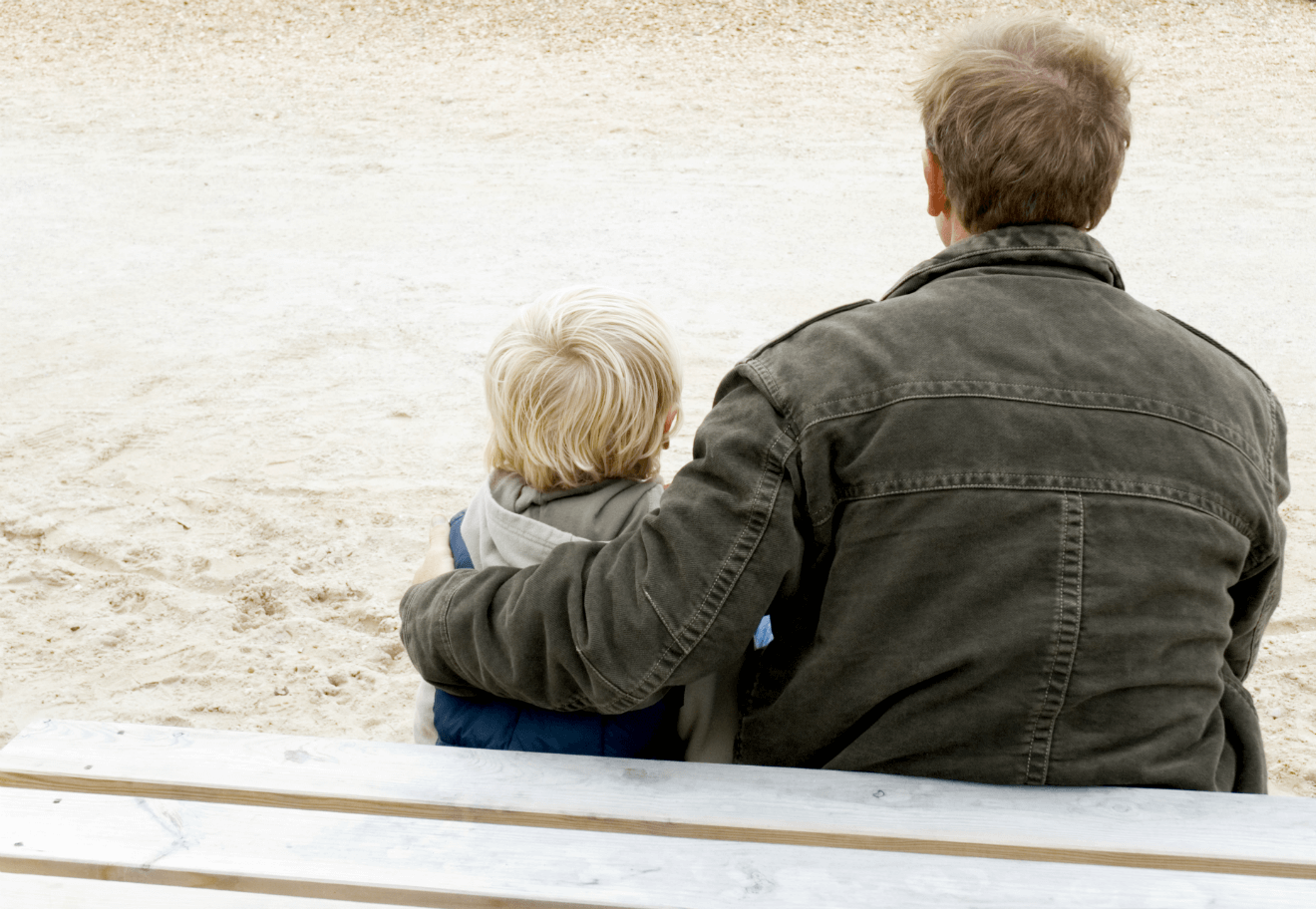 divorced dad with son on park bench