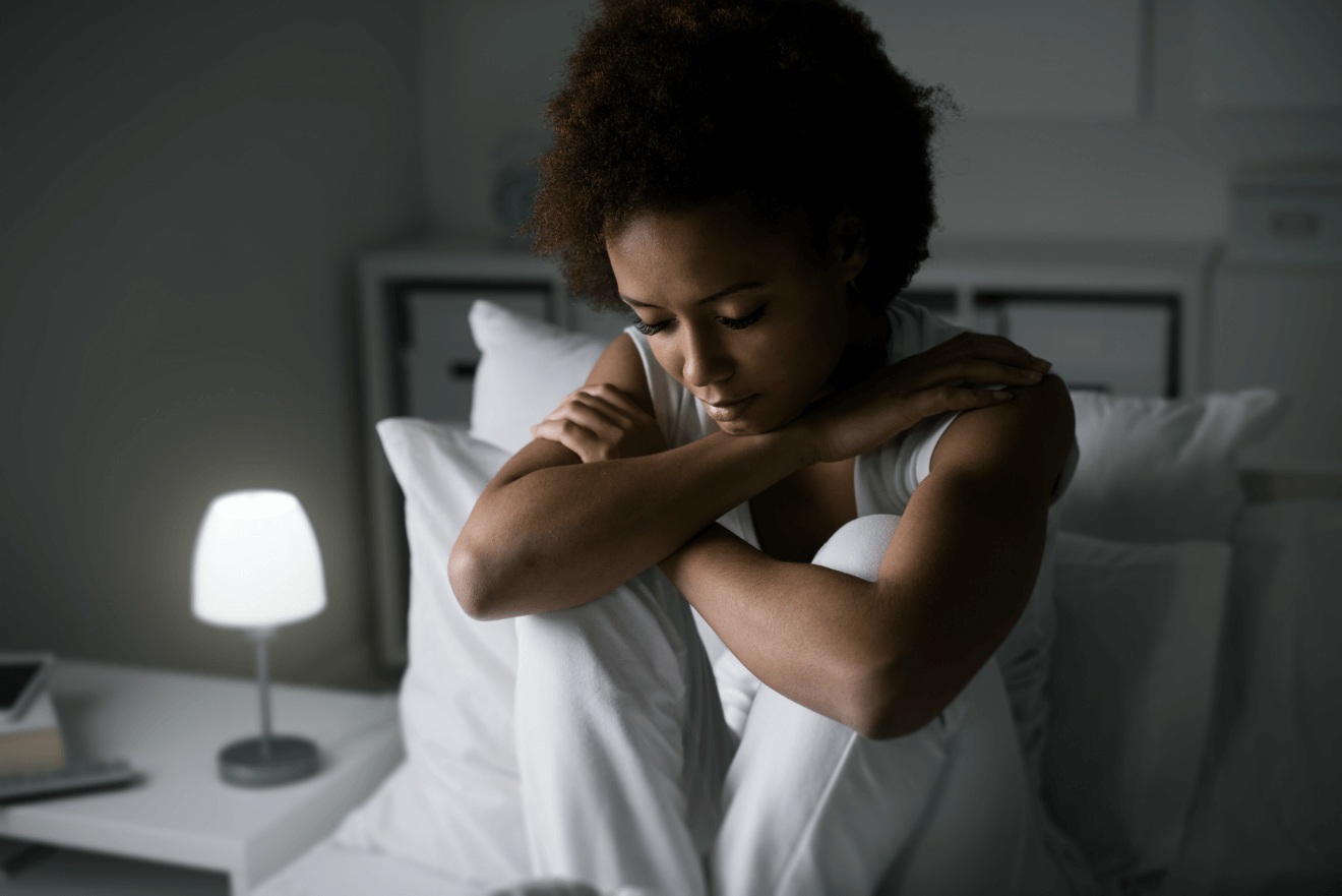 woman in bed anxiety light on