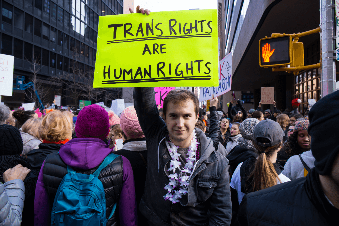 trans rights sign male activist rally