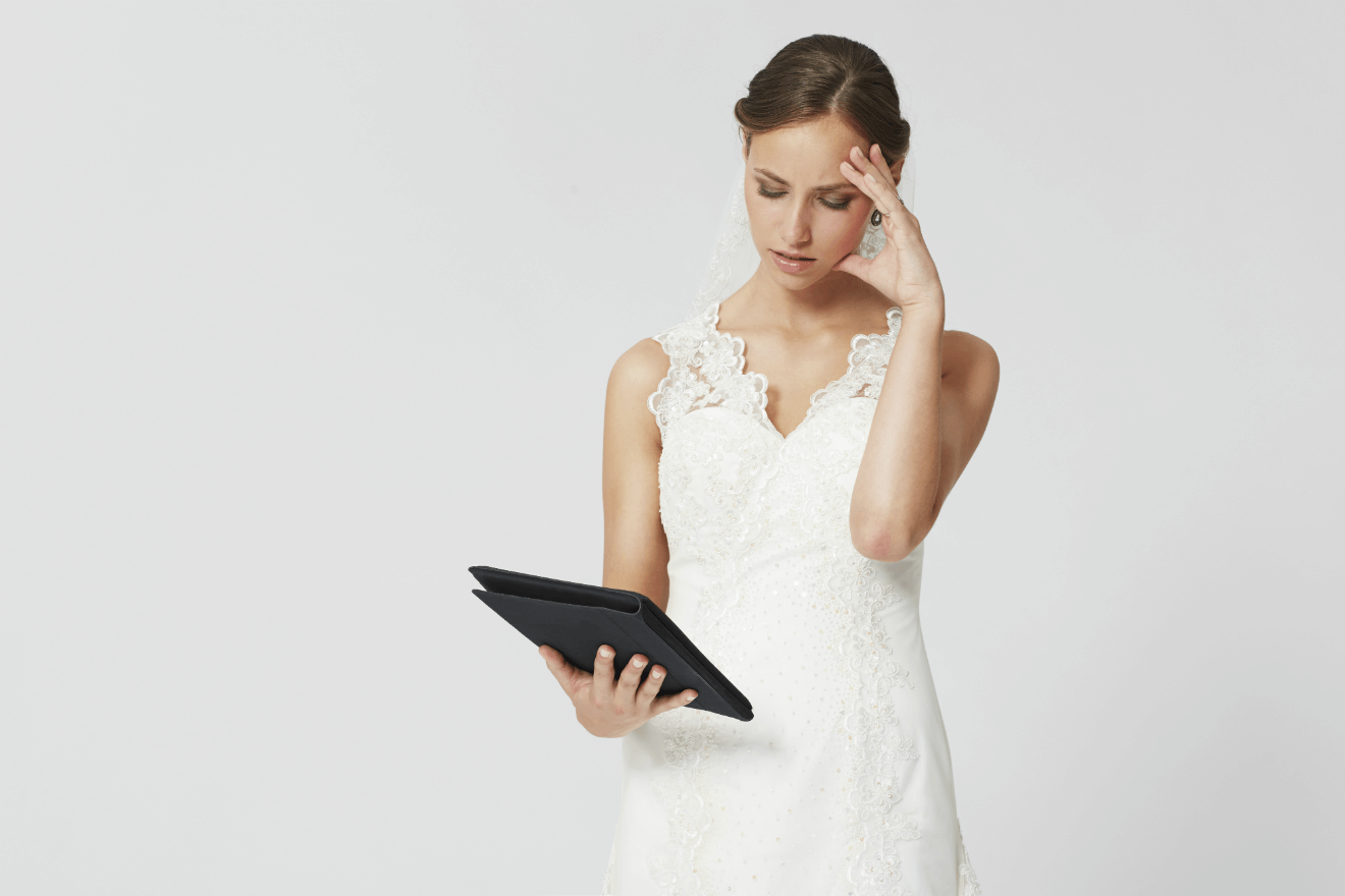 bride planning wedding on tablet