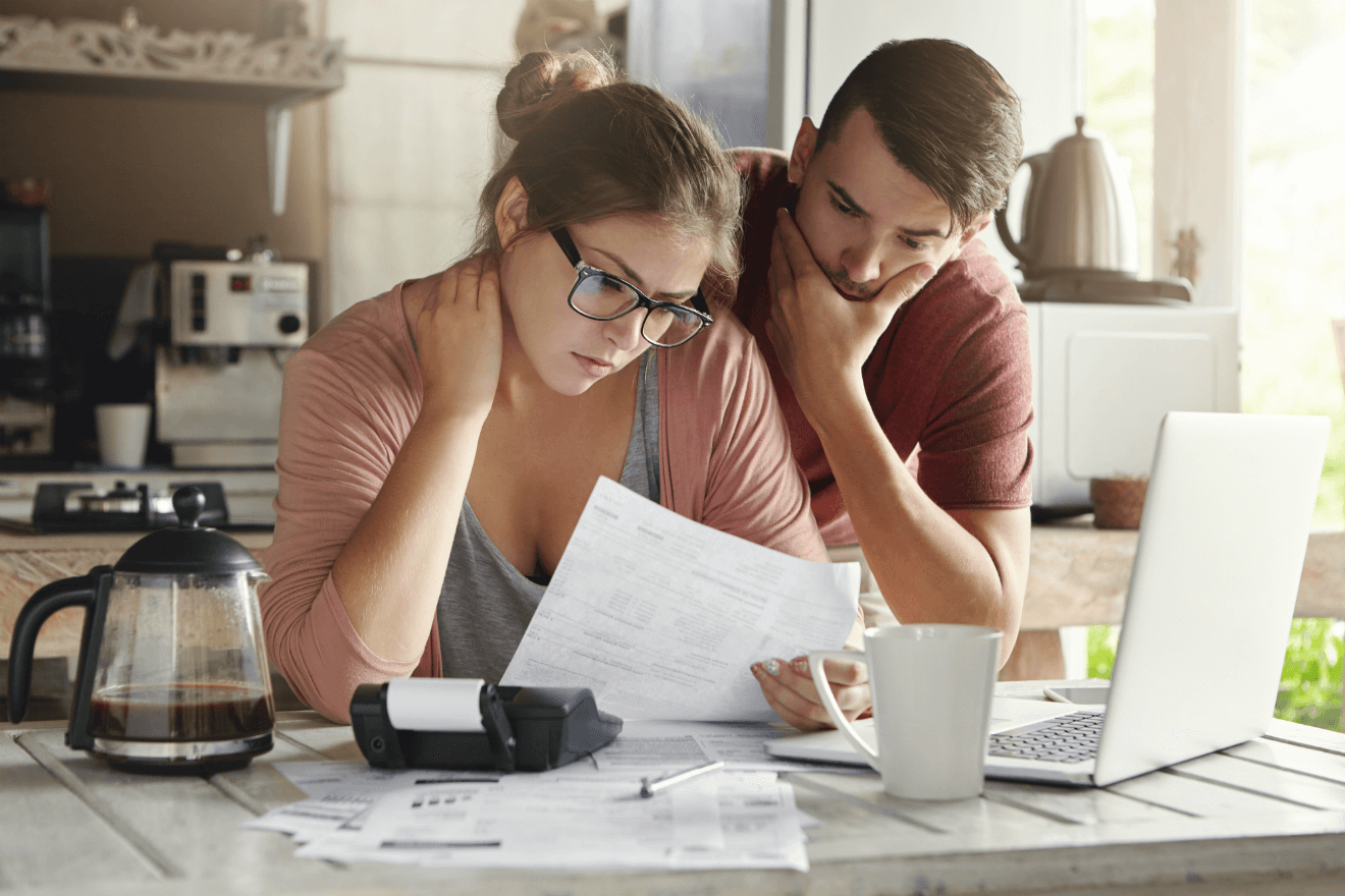 man woman couple looking at finances