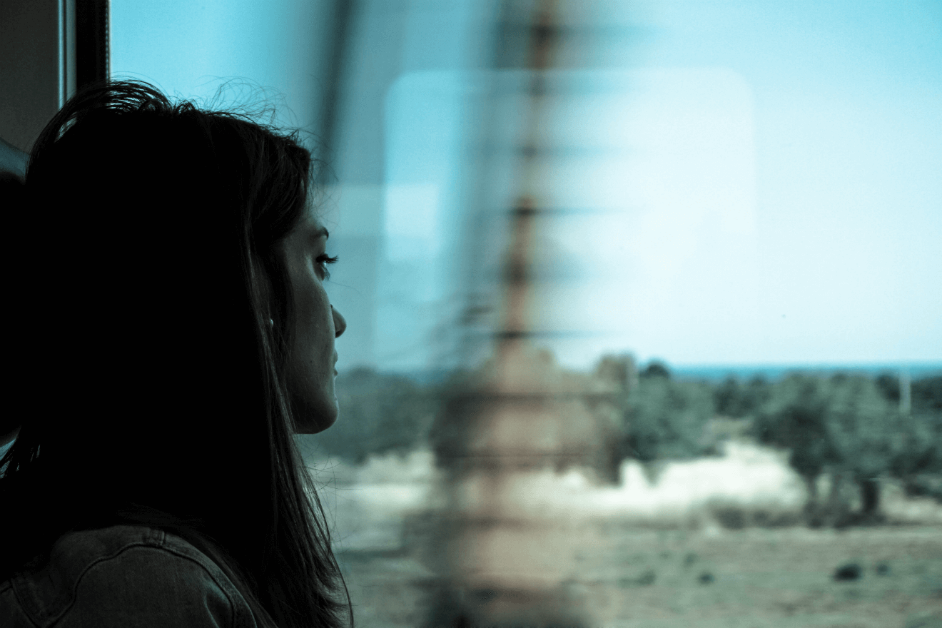 woman traveling on train blurred view