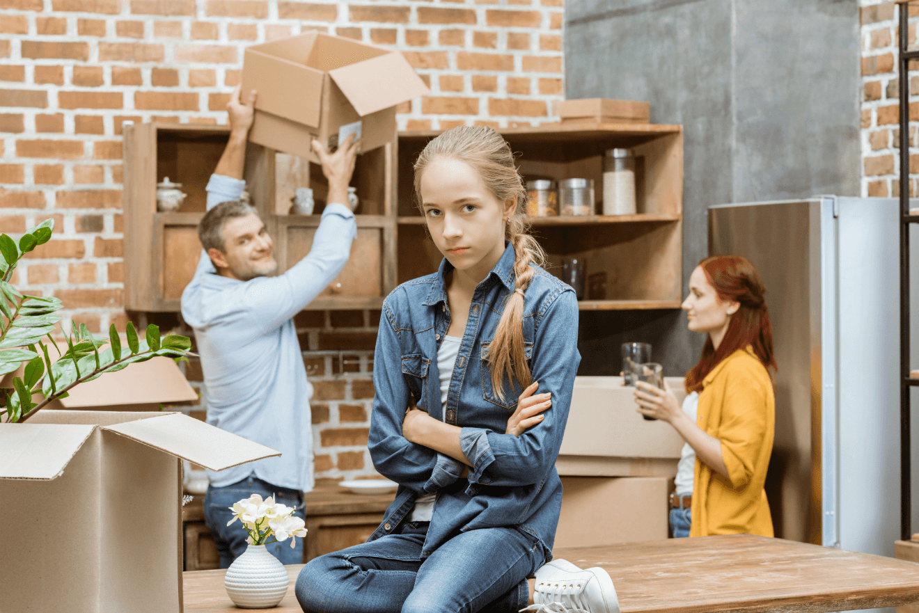 unhappy girl arms folded moving with parents