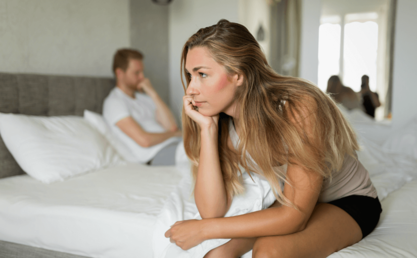 woman with sex anxiety and man in bed