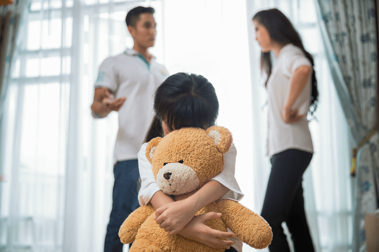 mother and father arguing sad daughter with teddy bear