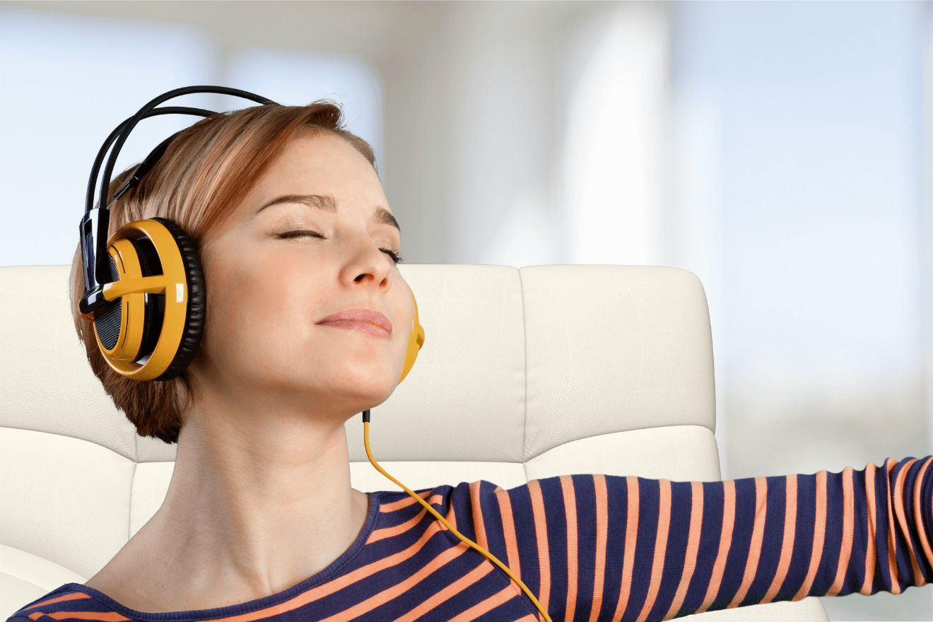 happy woman using headphones and listening to music