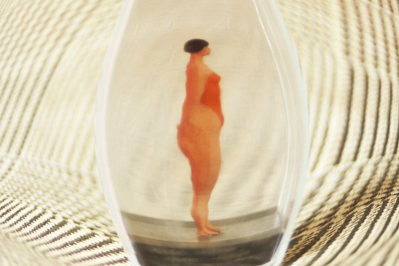female doll in glass jar