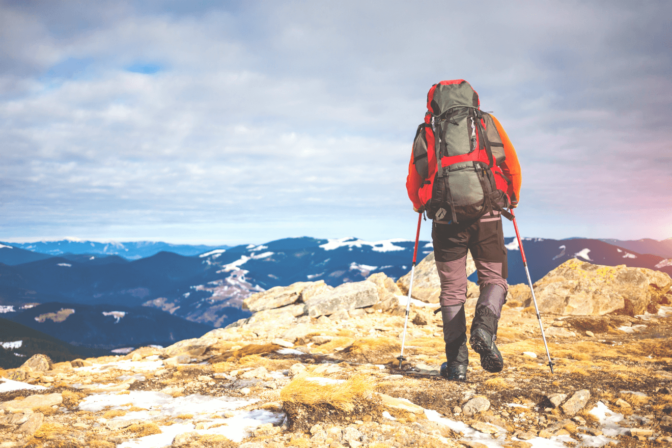 man hiking in mountain wearing gear