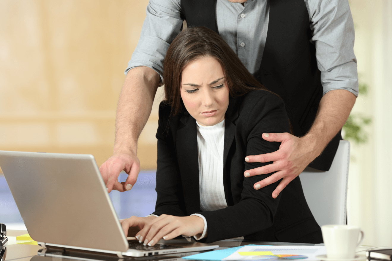 women at work uncomfortable with male co-worker touching her on arm