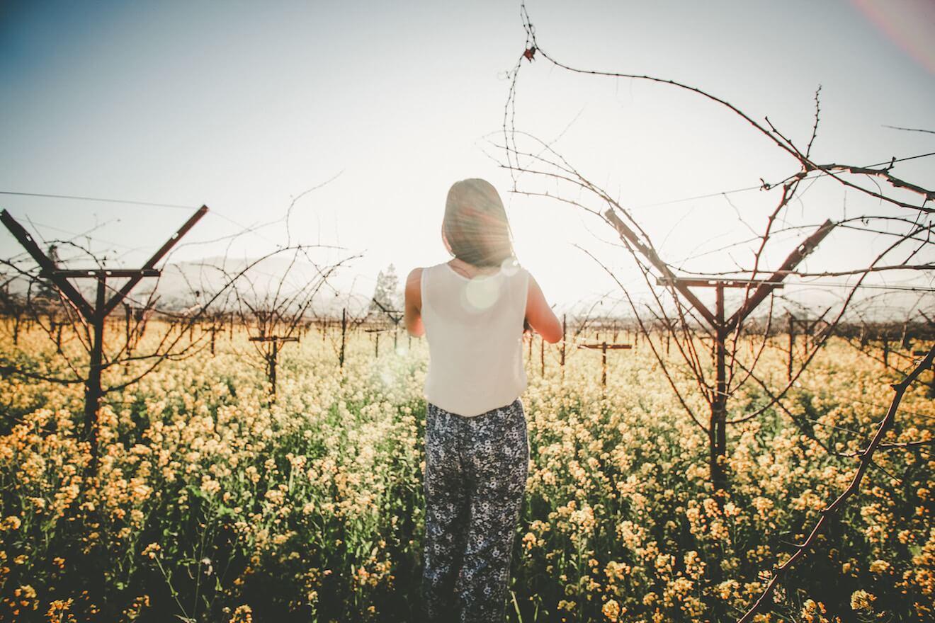 Woman in field of flowers