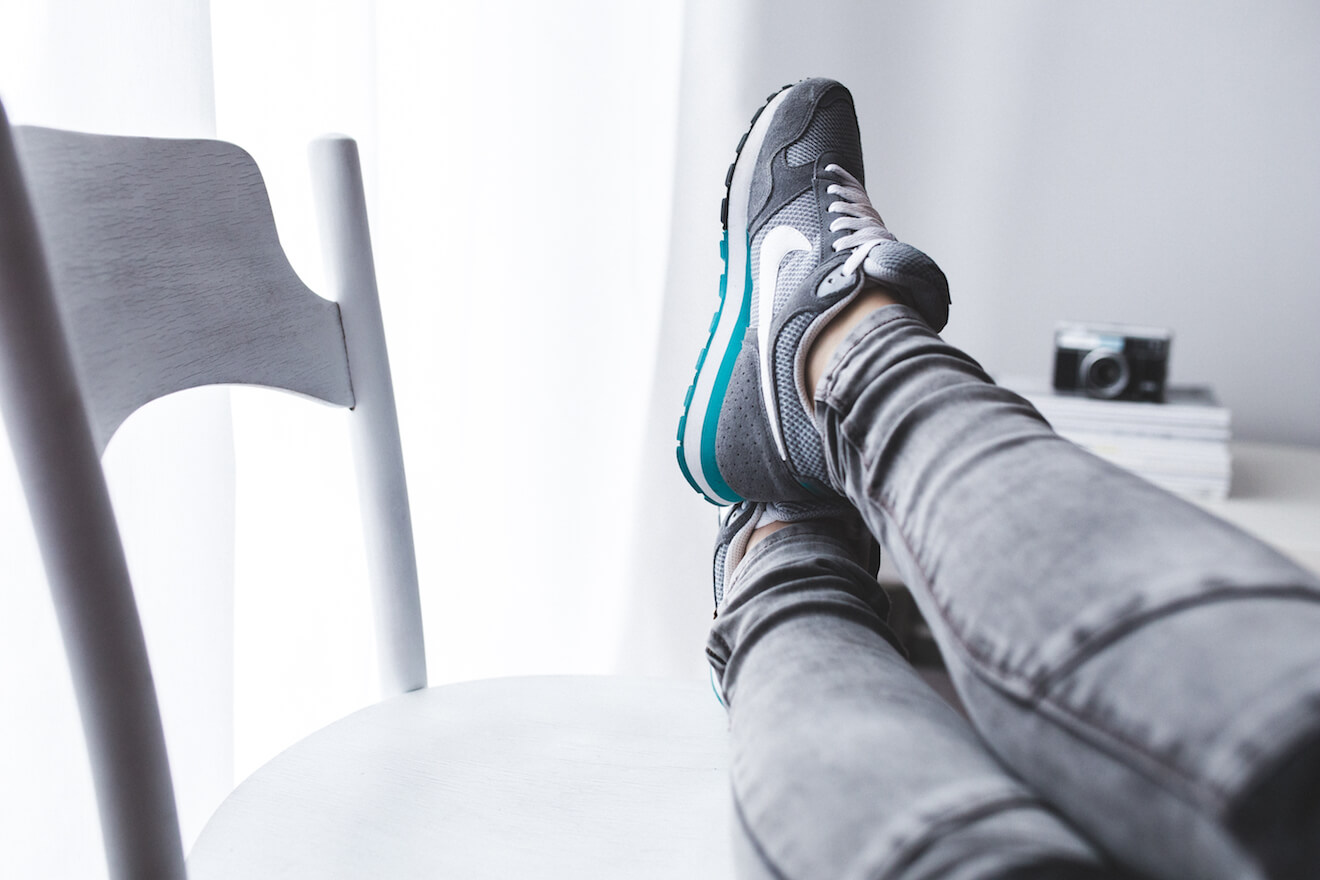Feet up on chair in bright room