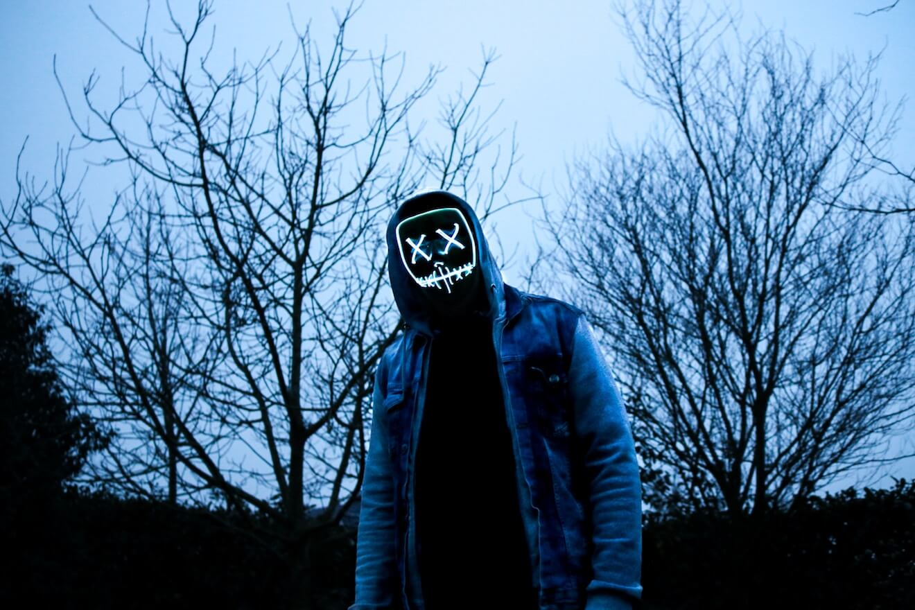 Man with hooded sweatshirt in a mask