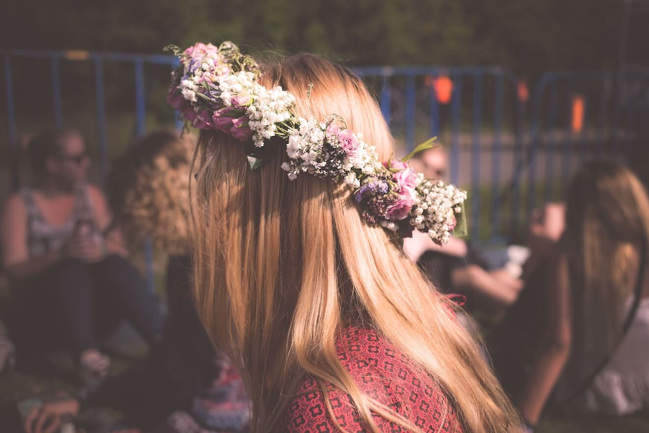 Woman in flower crown at music festival