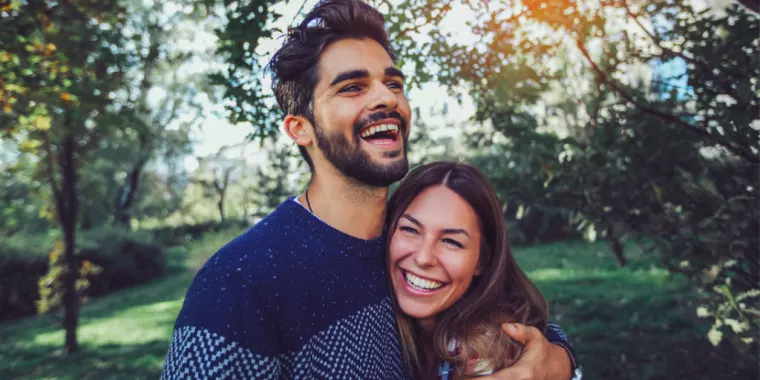 Couple laughing and holding each other