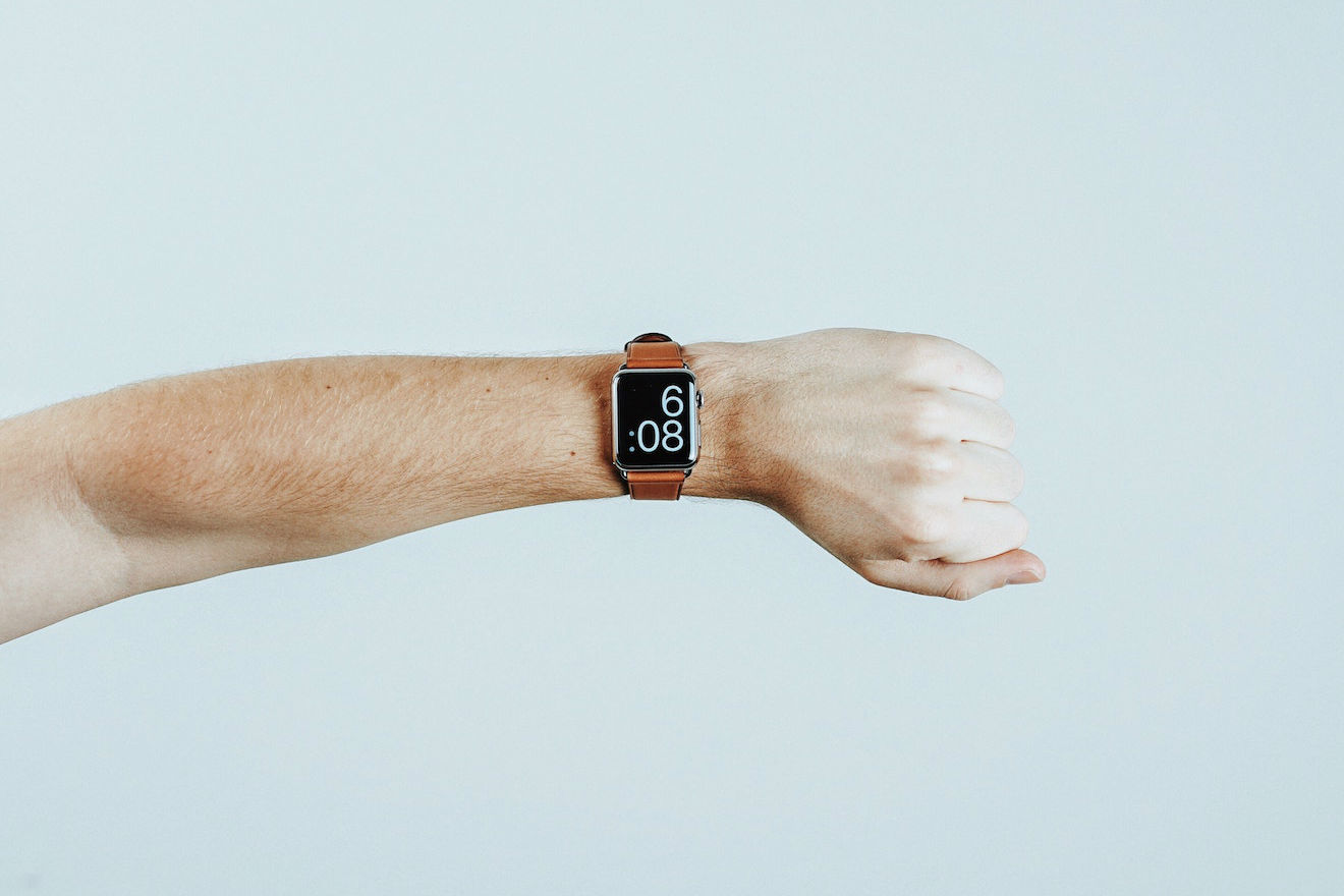 A person's arm with a watch