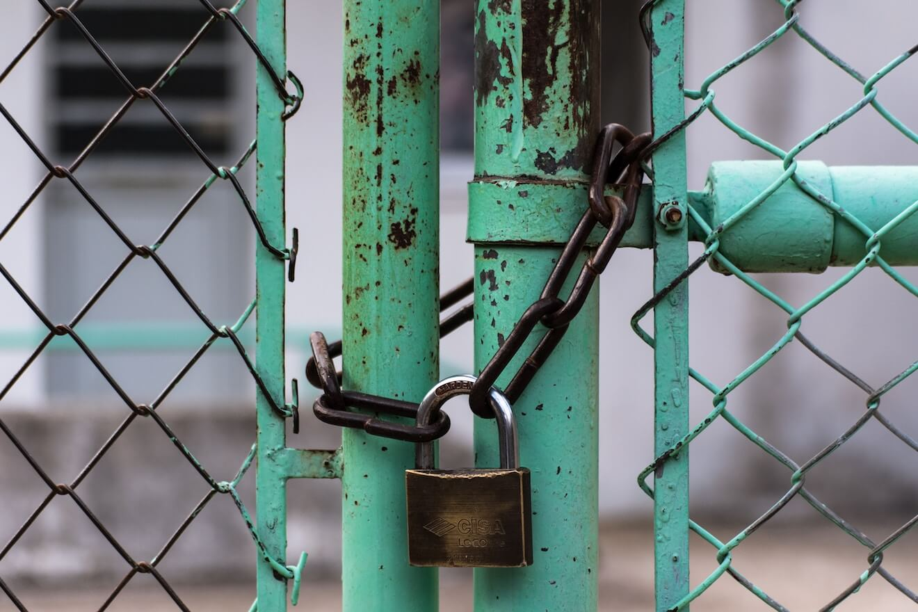 Lock on a teal fence