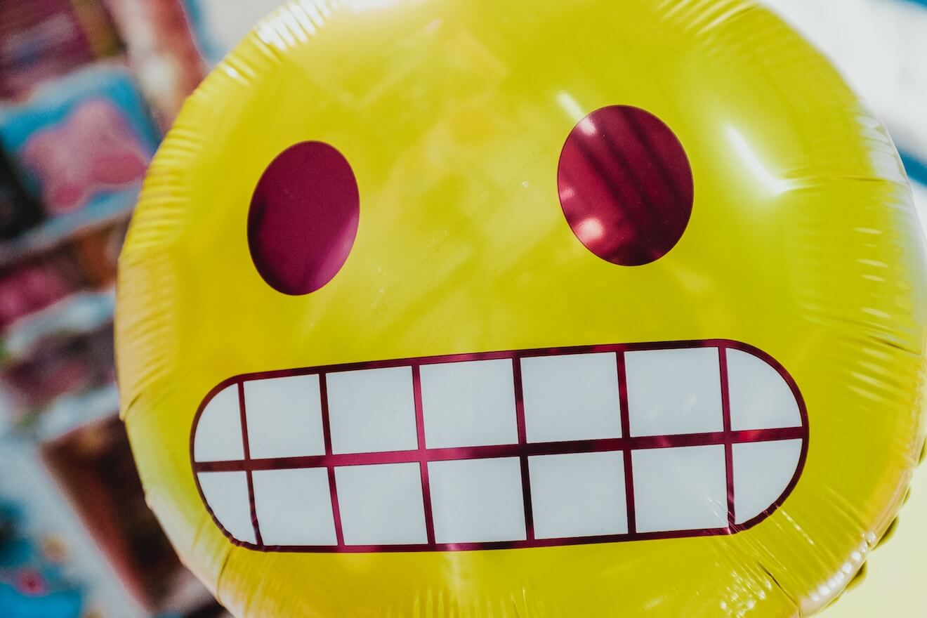 Grimacing emoji balloon