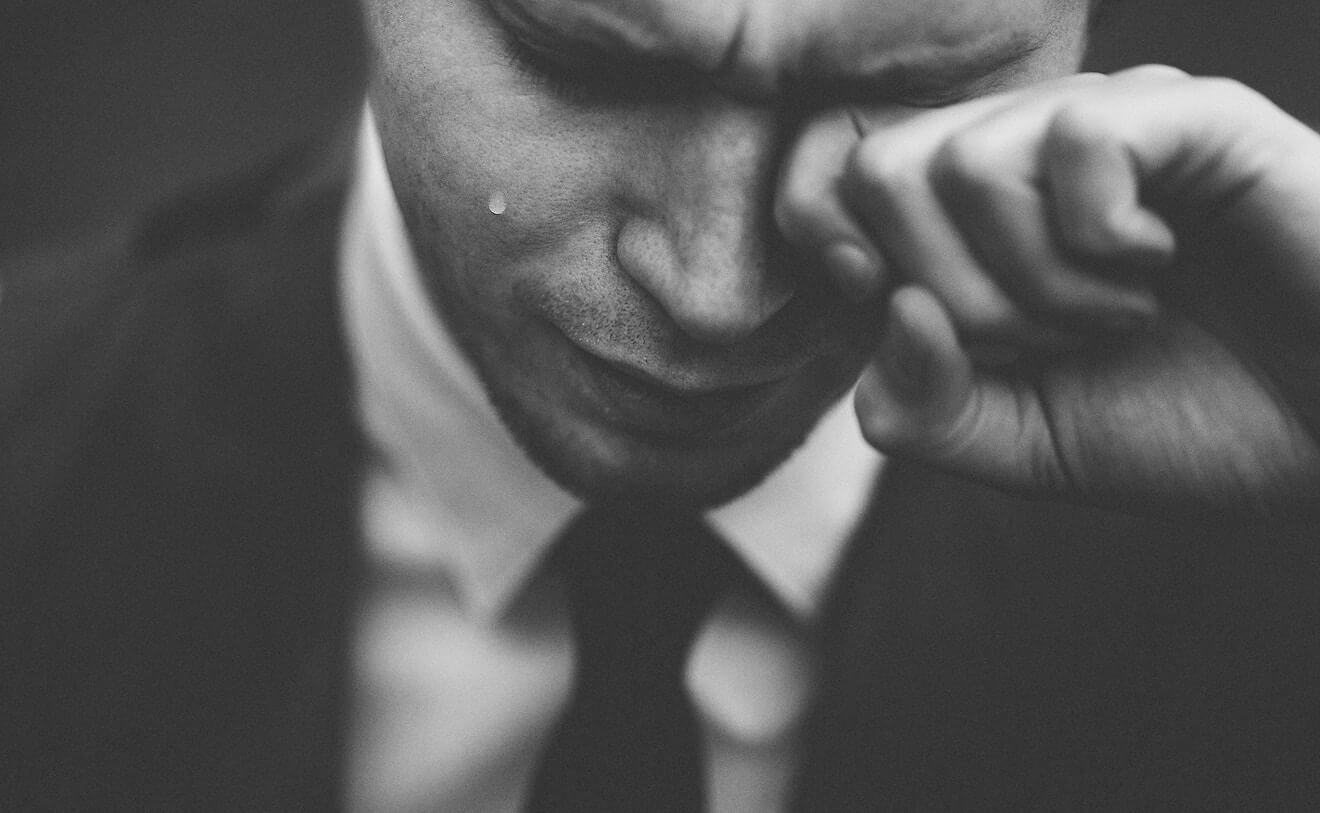 man in business suit crying