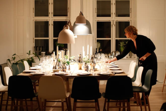 A woman sets a large table alone