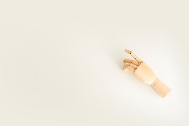 A wooden hand on a white background