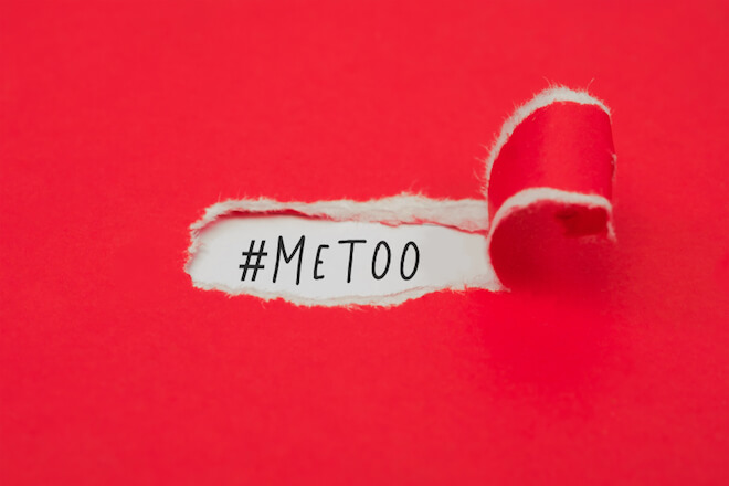"A torn red piece of paper exposes the words ""#MeToo"""
