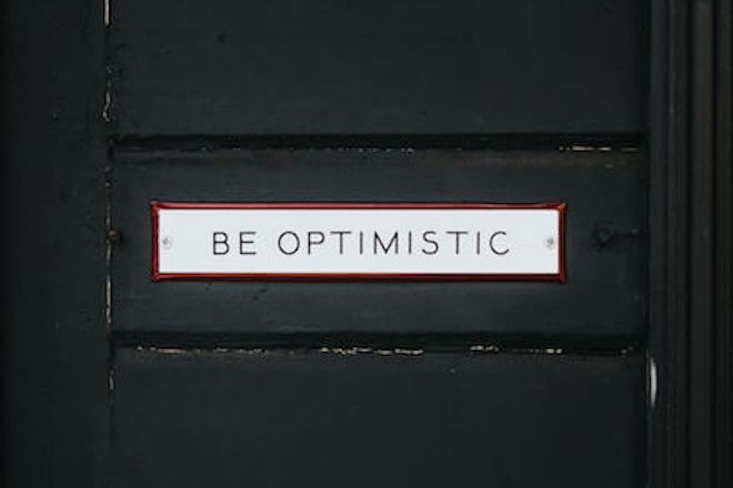 "A sign that says ""Be optimistic"""