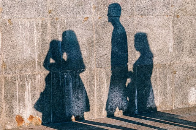 Shadow of Family Projected onto a Wall