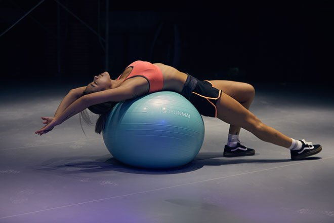 Woman stretching on exercise ball
