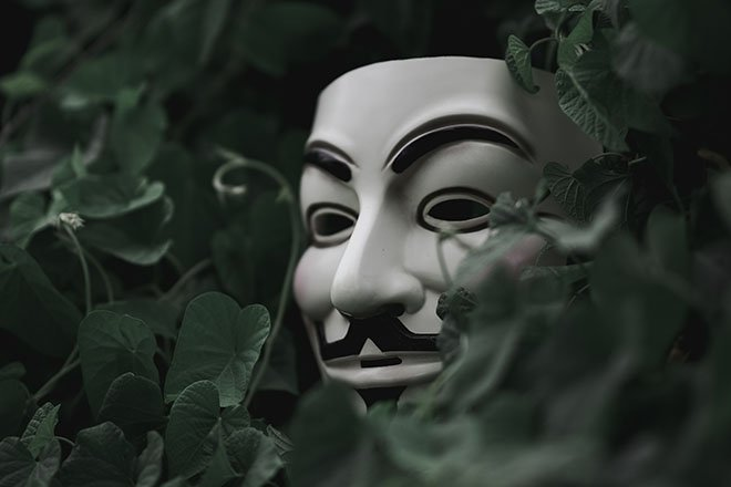 Spooky mask coming out of trees