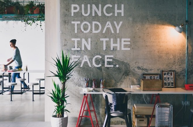 "a wall tells you to ""punch today in the face"""