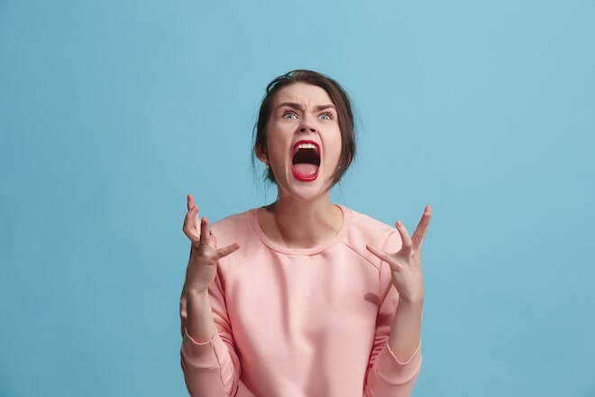 A woman screaming in anger