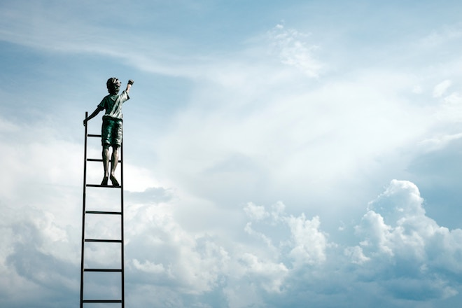 A child climbs a ladder and reaches for the sky
