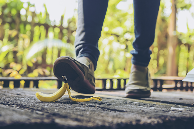 Person stepping on a banana