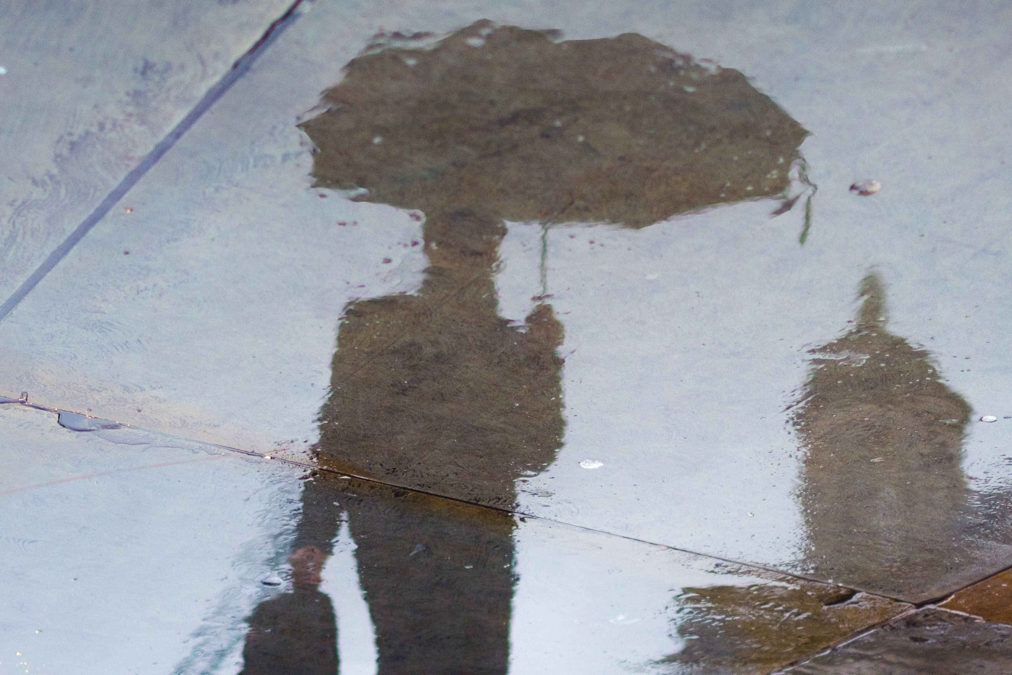 Shadow of man walking in the rain