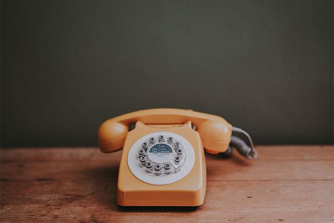 Orange telephone on a table