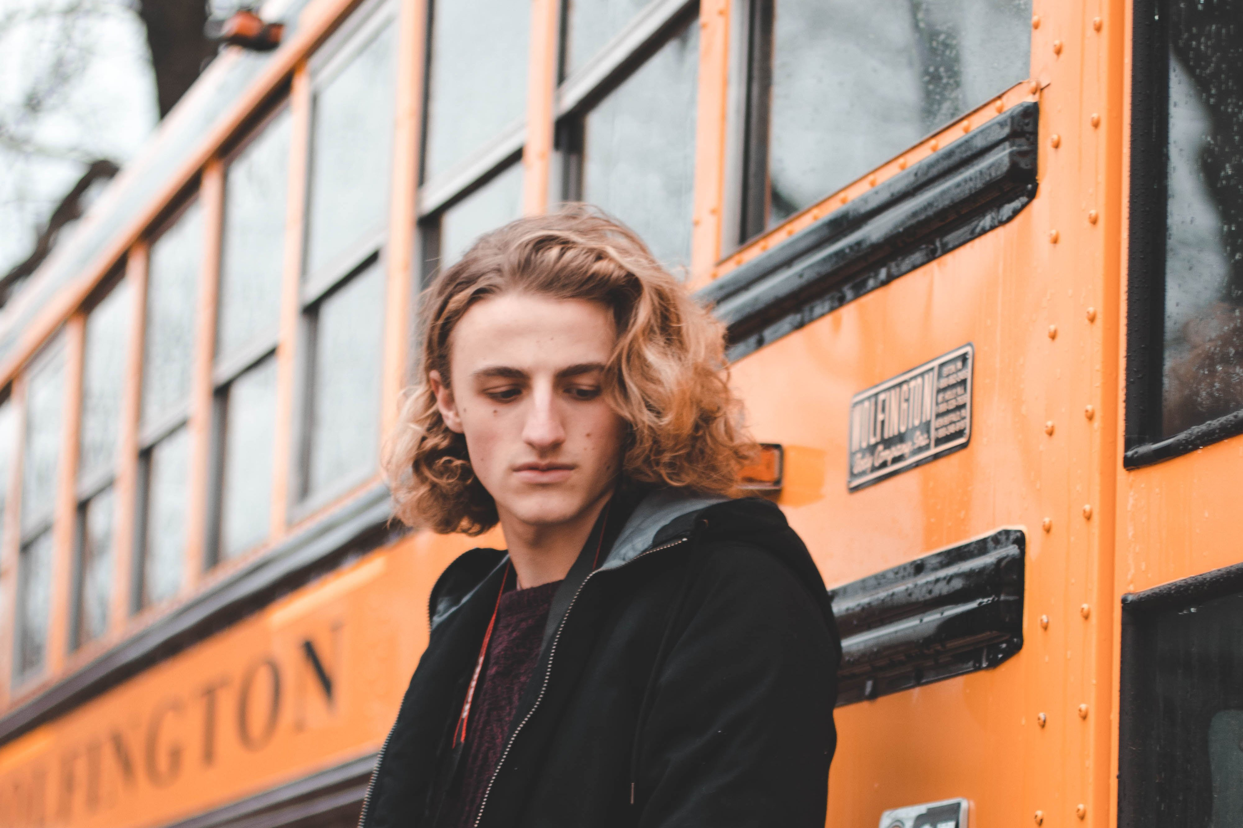 Person standing in front of school bus