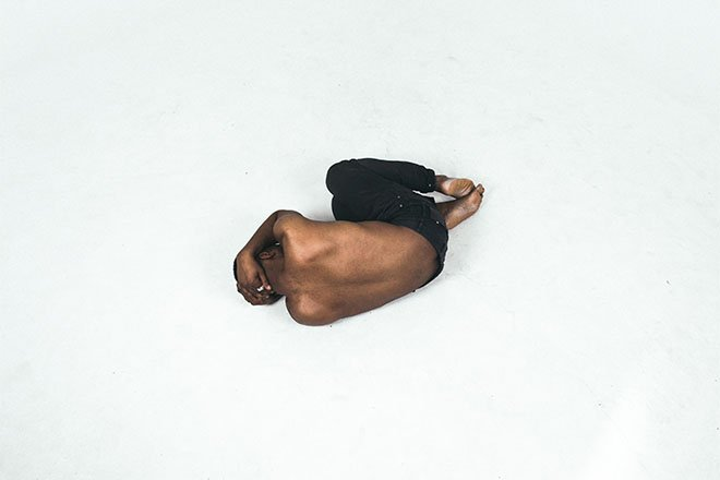 Man curled up on the floor