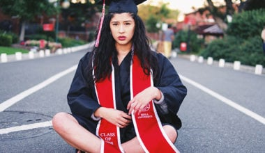 Worried woman in graduation gown