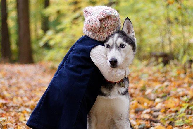 Child holding dog