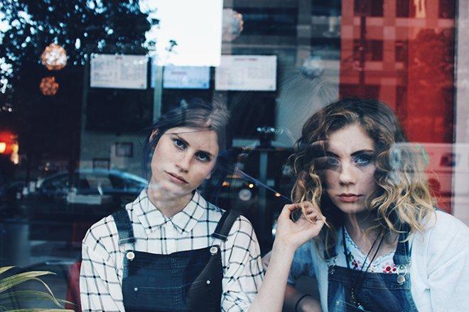 Two women in window