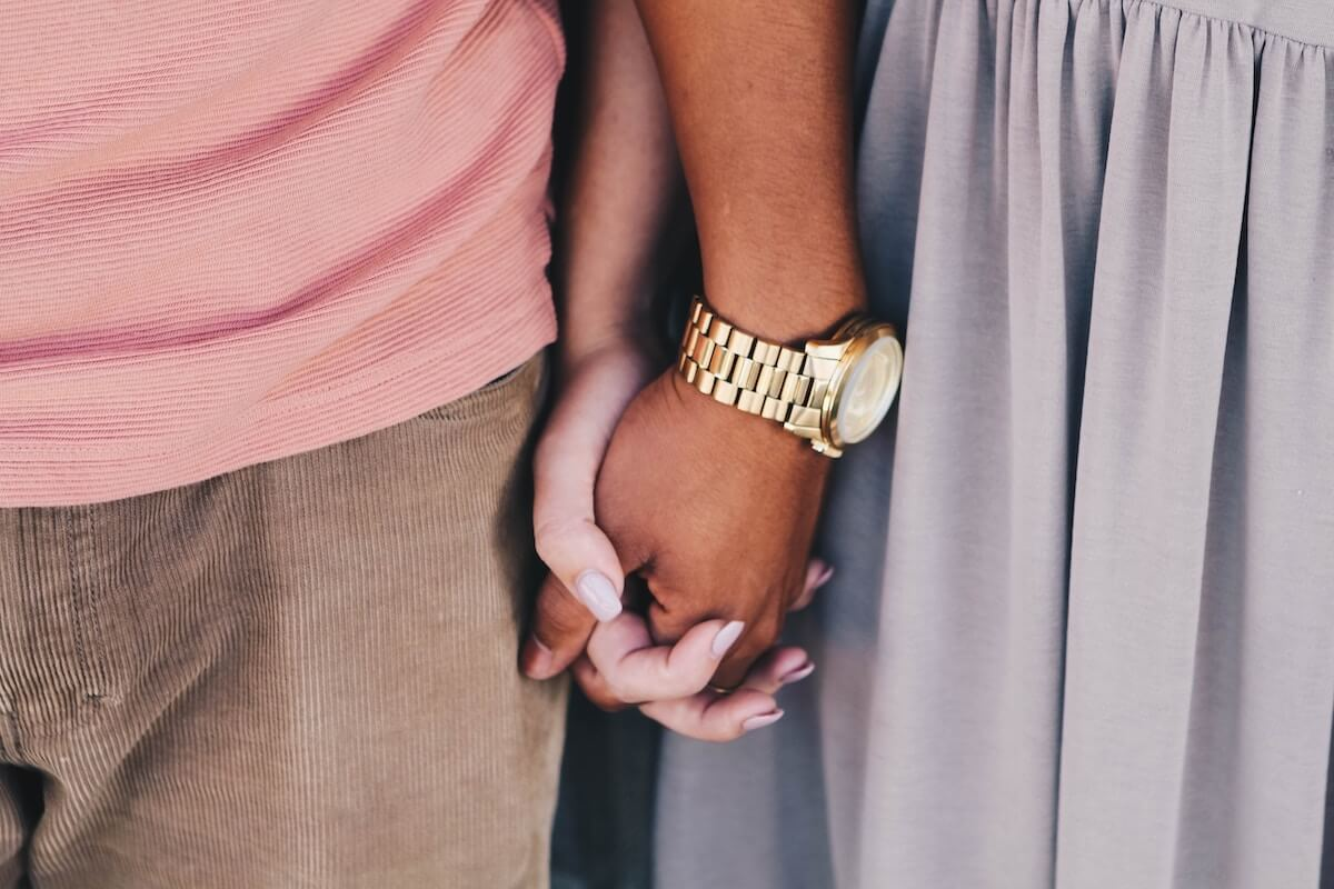 couple holding hands and standing together closely