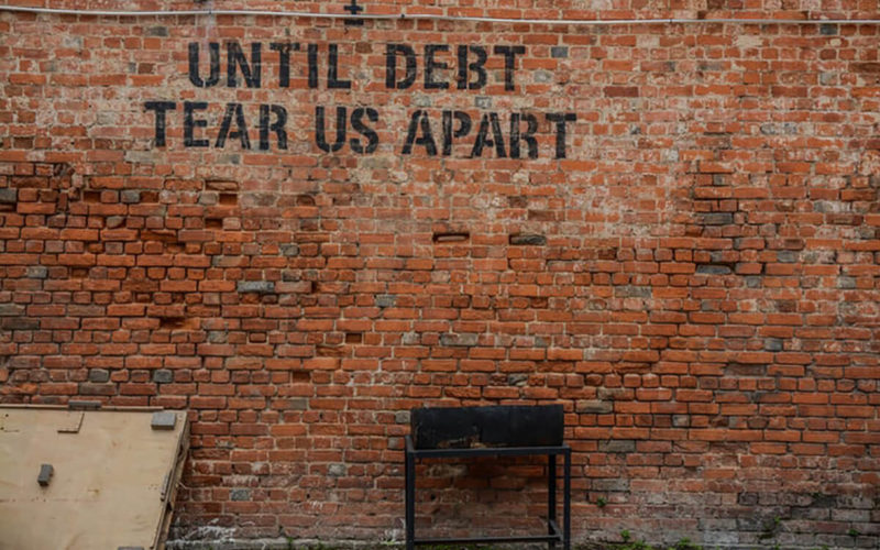 Until debt tear us apart sign
