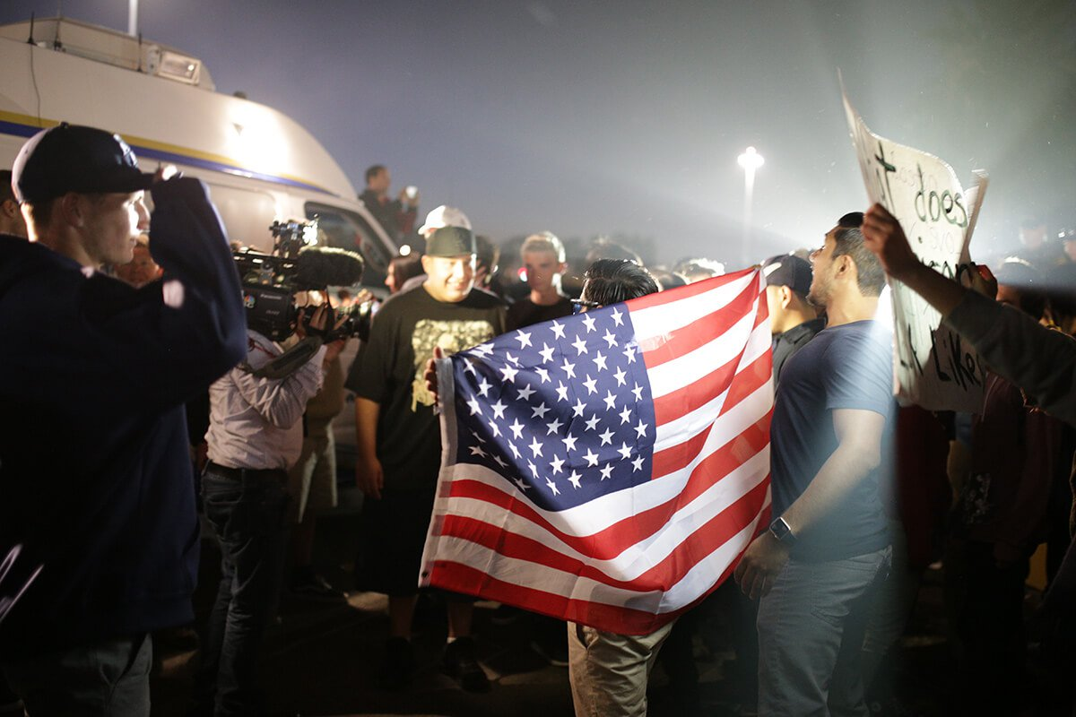 protesters with American flag