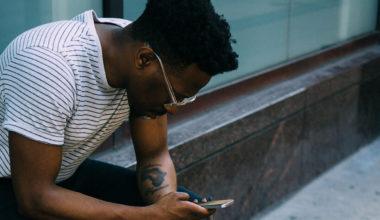Man looking down at phone texting