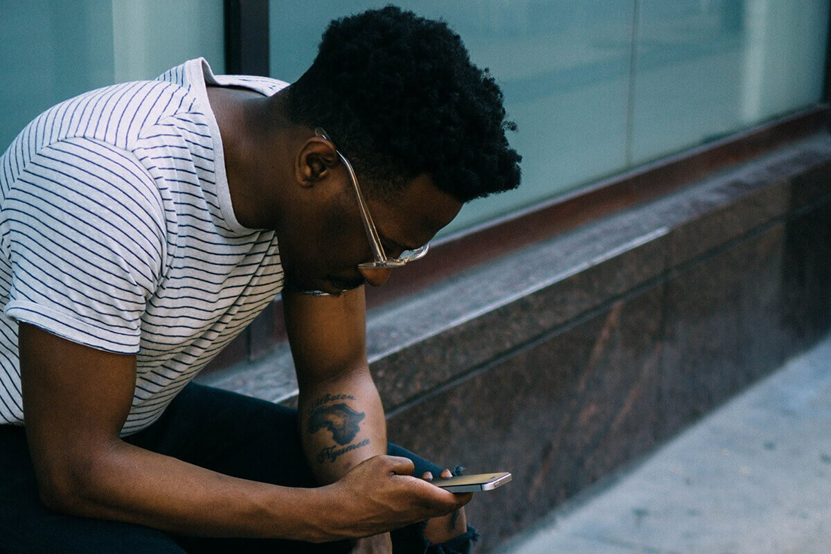 Man looking down at phone texting